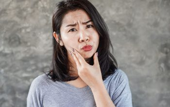 asian-woman-having-problem-with-facial-palsy