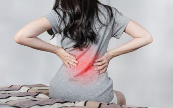 young-woman-suffering-from-back-pain-bed-after-waking-up